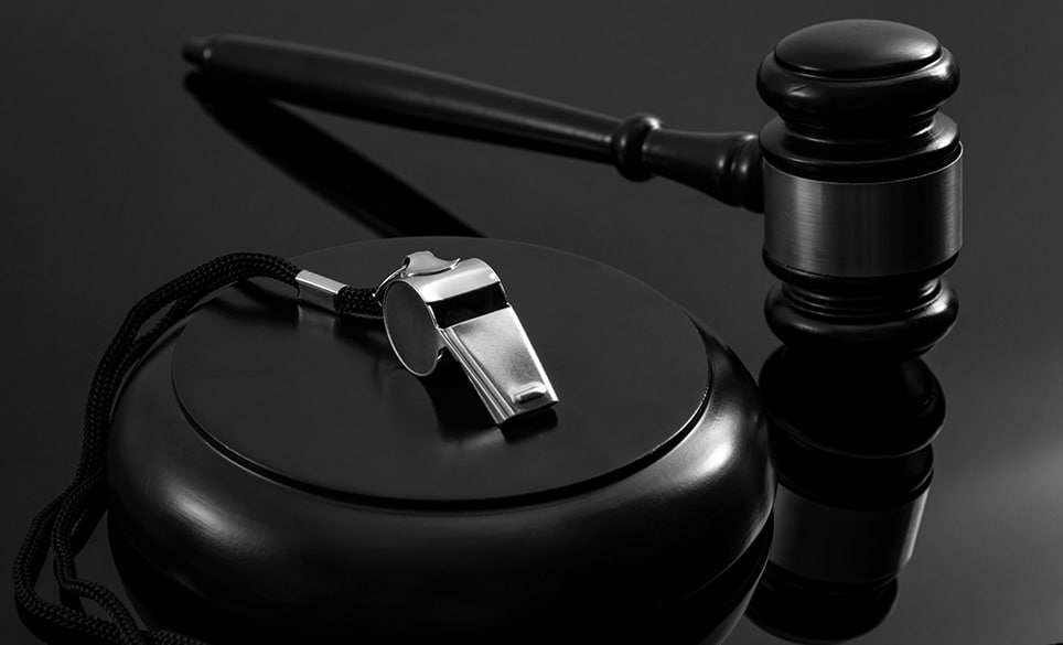 Whistleblower protection law and freedom of information legislation conceptual idea with metal whistle and wooden judge gavel on dark background